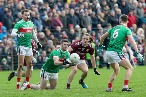 Mayo's Brendan Harrison and Kieran Molloy of Galway in action on Sunday.