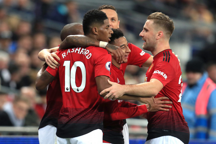 Rashford celebrates with team-mates after giving his side the lead.