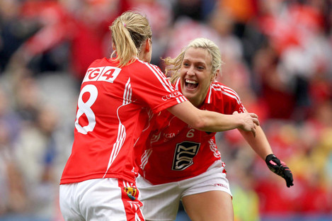 Brid Stack celebrates at the final whistle of the 2011 All-Ireland Ladies Senior football final with Cork team-mate Juliet Murphy.