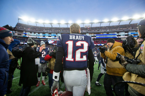 New England Patriots quarterback Tom Brady (12) heads off the field at the end of the AFC Divisional playoff game.