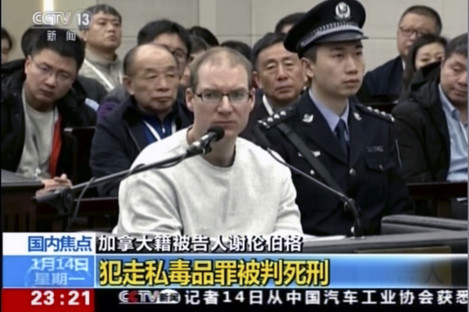 In this image taken from a video footage run by China's CCTV via AP Video, Canadian Robert Lloyd Schellenberg attends his retrial.