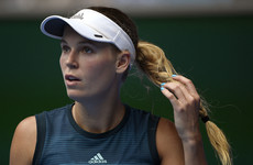 Federer and Wozniacki stay on track as other top players crash out