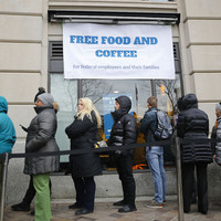Cash-strapped federal workers flock to food banks amid US government shutdown