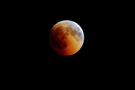 The moon is seen during a lunar eclipse in July 2018.
