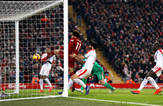Salah scores landmark goal as Liverpool survive scare to extend lead at top