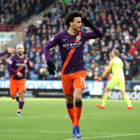 Man City ease past Huddersfield to close the gap on Liverpool
