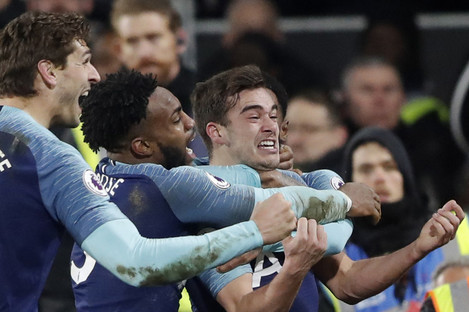Tottenham Hotspur's Harry Winks, right, celebrates.
