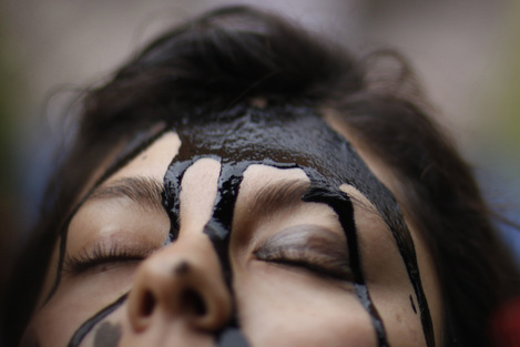 Activists in Mexico protested during the hearings by pouring black ink on their faces.