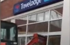 Digger smashes through front of Travelodge hotel in Liverpool
