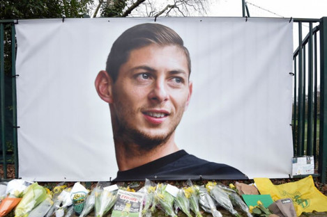 Flowers and tributes are placed near a giant picture of Argentine soccer player Emiliano Sala outside the FC Nantes training camp yesterday.