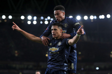 Sanchez celebrates giving Man United the lead against Arsenal.
