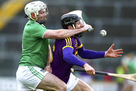 Tom Condon and Liam Og McGovern compete for possession.