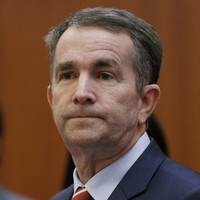 US governor apologises over appearing in 'clearly racist and offensive' photo