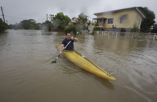 Once-in-a-century floods turn streets to rivers in northeastern Australia