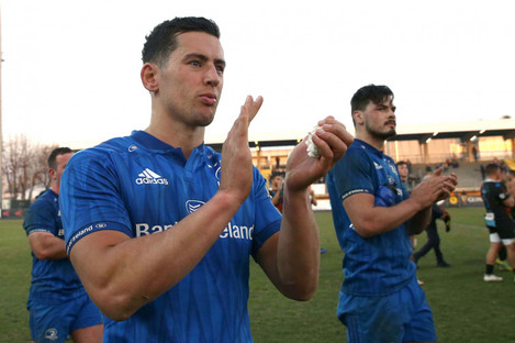 Noel Reid and his Leinster team-mates celebrate after the game.