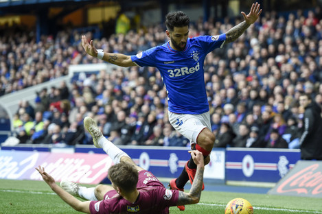 St Johnstone's Jason Kerr and Rangers Daniel Candeias in action.