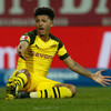 Leaders Dortmund drop more points as fans throw black tennis balls onto pitch