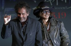 VIDEO: Dark Shadows director Tim Burton falls off stage...