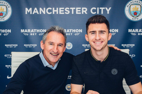 Manchester City's director of football, Txiki Begiristain, with Aymeric Laporte.