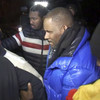 R Kelly hands himself into police following 10 sex abuse charges