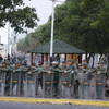 Venezuelan forces fire tear gas at crowd demanding to cross bridge into Colombia