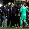 Furious Pochettino confronts referee Mike Dean after defeat at Burnley