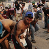 At least two people die and over 300 hurt as Venezuela border standoff turns deadly