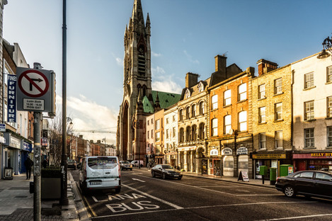 Thomas Street in Dublin. The development at 61/62 is to the left of the photo, while number 130 is further down the street past the church