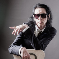 John Cooper Clarke: 'I heard on the news that Bono's leather pants were robbed, so I put it to rhyme'