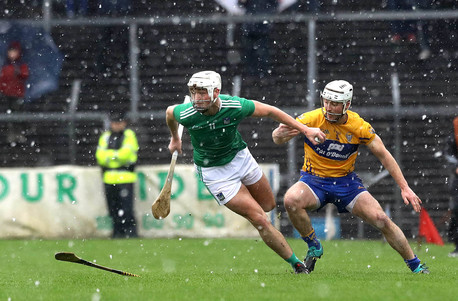 Kyle Hayes escapes the challenge of Colm Galvin.