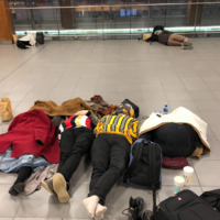 Passengers sleep on the floor at Dublin Airport after snow and ice causes major delays