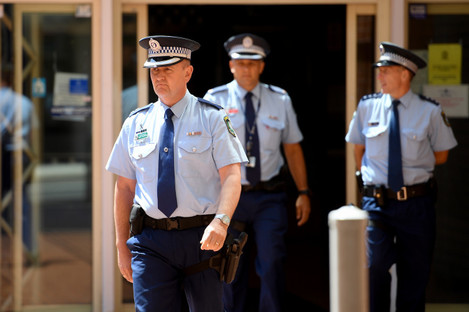 NSW Police Superintendent Brett McFadden (centre) arrives to address media at a press conference at Penrith Police Station.