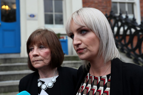 Clodagh Hawe's mother Mary Coll (left) and her sister Jacqueline Connelly leaving the Department of Justice