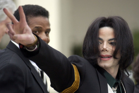 Michael Jackson waves to his supporters as he arrives for his child molestation trial in California in 2005.