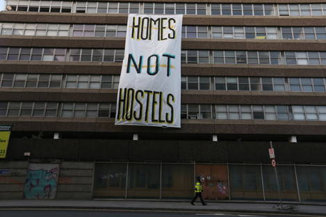 'Homes not Hostels' banner hanging outside the Apollo House that was occupied by groups protesting the homelessness crisis.