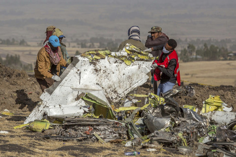 Rescuers work at the scene of an Ethiopian Airlines flight crash near Bishoftu, or Debre Zeit, south of Addis Ababa in Ethiopia yesterday.