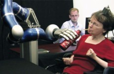 VIDEO: Paralysed woman uses mind to move robot arm