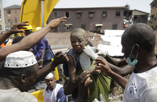 Eight killed and dozens injured after building housing 'illegal school' collapses in Nigeria