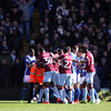 Birmingham and Arsenal charged over pitch invasions