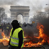 Mother and child saved from apartment building set on fire by yellow vest protesters in Paris