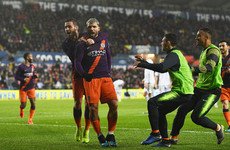 Controversial Aguero winner keeps City's quadruple hopes alive
