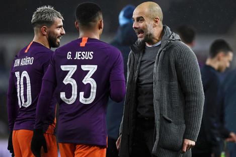 Guardiola celebrates City's late win.