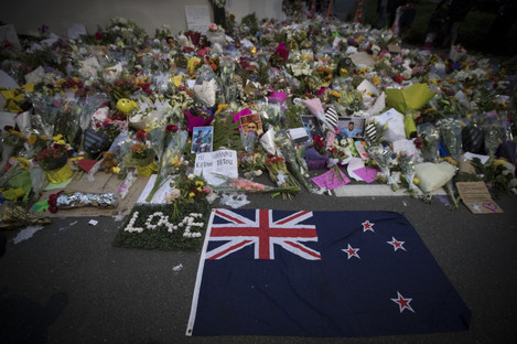 Mourners lay flowers outside the Al Noor mosque in Christchurch