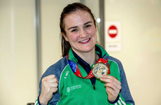 Kellie Harrington auctions off belt to raise money for neighbours who lost their home to fire