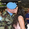 In pictures: Irish troops arrive home to smiles and smooches