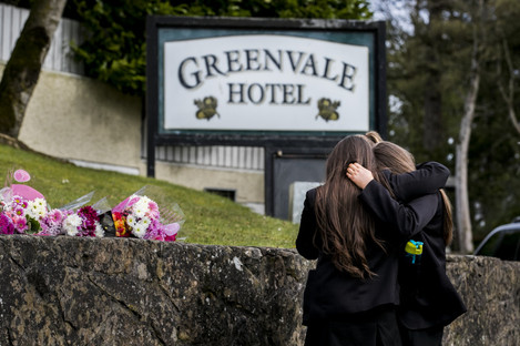 Students leave floral tributes outside the Greenvale Hotel in Cookstown, Co Tyrone