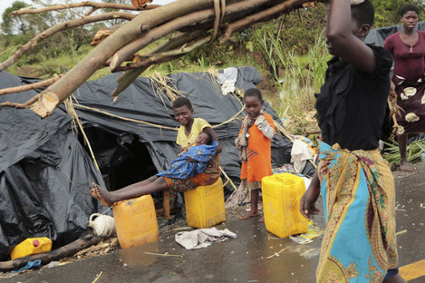 Survivors of Cyclone Idai in a makeshift shelter by the roadside near Nhamatanda about 50 kilometres from Beira, in Mozambique,