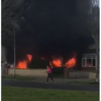 Man (40s) arrested after apartment complex and two cars set on fire in north Dublin