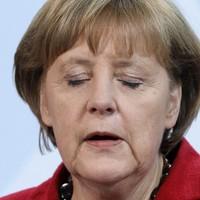 Did Angela Merkel say Greece should hold a referendum on euro membership?