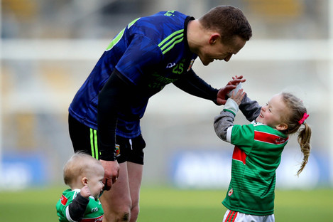 Andy Moran celebrates Mayo's win with his children Ollie and Charlotte.